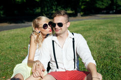 Attractive couple on a date in park Stock Image