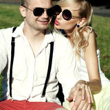 Attractive couple on a date in park Stock Images