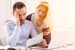 Attractive couple doing administrative paperwork. View of a Attractive couple doing administrative paperwork Royalty Free Stock Photo