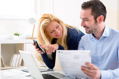 Attractive couple doing administrative paperwork Stock Photo