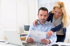 Attractive couple doing administrative paperwork Stock Image