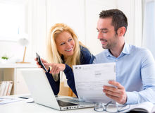 Attractive couple doing administrative paperwork Stock Images