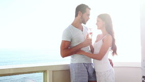 Attractive couple drinking champagne together. At home on the balcony stock video footage