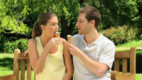 Attractive couple eating ice creams stock video