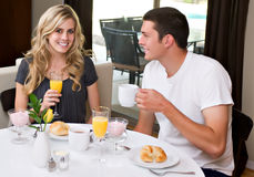 Attractive couple eats breakfast Stock Images