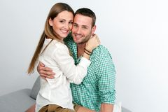 Attractive couple embracing indoors. Royalty Free Stock Photos