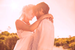 Attractive couple embracing by the road Royalty Free Stock Image