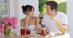 Attractive couple enjoying breakfast outdoors Royalty Free Stock Photography