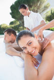 Attractive couple enjoying couples massage poolside Royalty Free Stock Photo