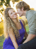 An Attractive Couple Enjoying A Day in the Park Stock Photo