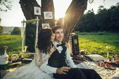 Attractive Couple Enjoying Romantic Sunset Picnic in the Country. Young couple in love having fun and enjoying the beautiful nature Royalty Free Stock Photography