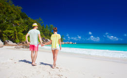 Attractive couple enjoying sunny day at Anse Georgette beach. Praslin, Seychelles Stock Images