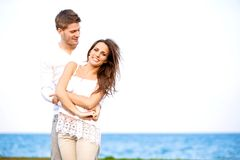 Attractive Couple Enjoying the Windy Beach Royalty Free Stock Image