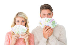 Attractive couple flashing their cash Stock Photo