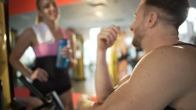 Attractive couple flirting after workout in gym, getting acquainted, hook-up. Stock footage stock footage