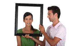 Attractive couple with frame Stock Image