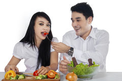 Attractive couple with fresh salad Royalty Free Stock Photo
