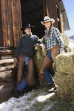 Attractive Couple In Front of Hay Bales Royalty Free Stock Photo