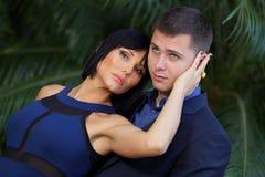 Attractive couple in a garden Stock Photos