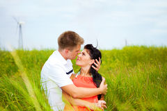 Attractive couple in grass Royalty Free Stock Images