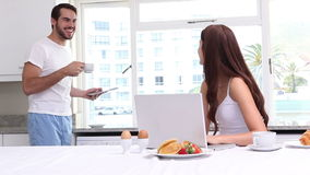 Attractive couple having breakfast together stock footage