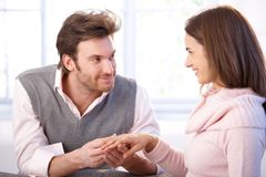 Attractive couple having engagement smiling Stock Photos