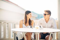 Attractive couple having first date.Blind date.Coffee with a friend.Smiling happy people having a coffee,dating. Getting to know each other.First romantic date Stock Photos