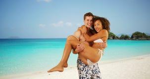 Attractive couple having fun in Caribbean coast. Stock Photo