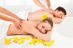 Attractive couple having a massage Stock Photos