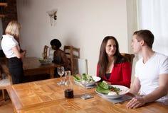 An attractive couple having a meal Stock Photos
