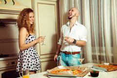 Attractive couple having party fun, drinking, laughing Royalty Free Stock Photos
