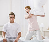 Attractive Couple Having a Pillow Fight Royalty Free Stock Photos