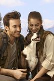 Attractive couple hiking with dog Stock Image