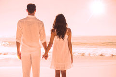 Attractive couple holding hands and watching the ocean Stock Photography