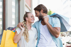 Attractive couple holding shopping bags Royalty Free Stock Photography