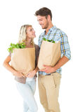 Attractive couple holding their grocery bags Royalty Free Stock Images