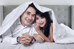 Attractive couple in the hotel bedroom Royalty Free Stock Images