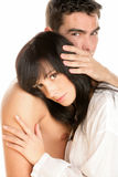 Attractive couple hugging. Young attractive couple hugging on white background Stock Photo