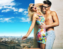 Attractive couple hugging over the city panorama Stock Photos