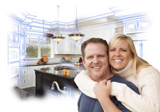Attractive Couple Hugging Over Custom Kitchen Drawing and Photo Stock Image