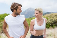 Attractive couple jogging on mountain trail Stock Image