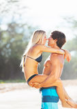 Attractive Couple Kissing on the Beach Stock Photo