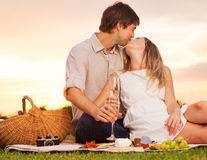 Attractive couple kissing on romantic picnic Stock Photo