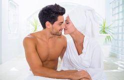 Attractive couple kissing in towels Stock Photography
