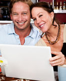 Attractive couple with laptop computer Royalty Free Stock Photo