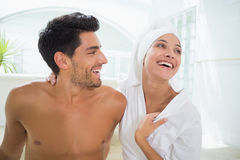 Attractive couple laughing in towels Royalty Free Stock Photo