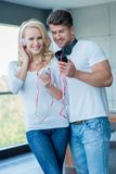 Attractive couple listening to music on headphones Royalty Free Stock Photo