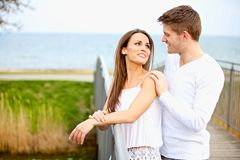Attractive Couple Looking at Each Other. Portrait of an attractive couple looking at each other while dating outdoors Stock Photography