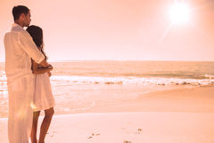 Attractive couple looking out at sea Stock Photos