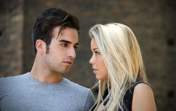 Attractive couple in love looking into each other's eyes Royalty Free Stock Photos